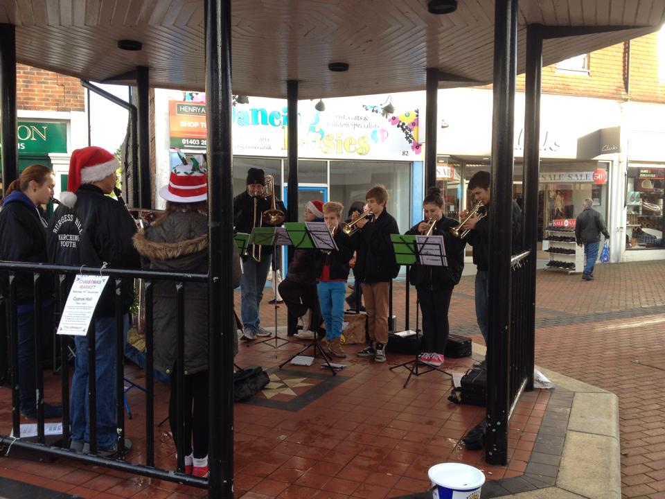 Playing carols at the bandstand in Burgess Hill
